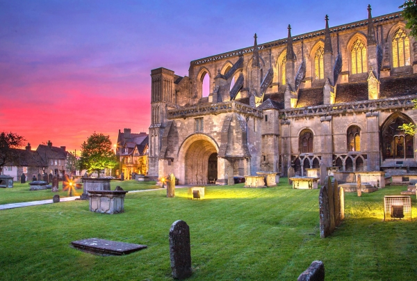Sunset at Malmesbury Abbey, star of Malmesburys Fun Facts by Blount and Maslin