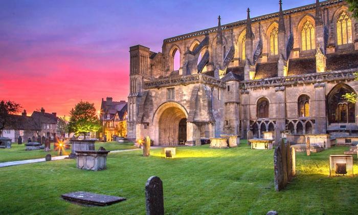 Sunset at Malmesbury Abbey, star of Malmesburys Fun Facts by Blount and Maslin